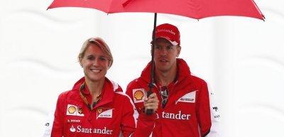 Sebastian Vettel und seine persönlicher Sprecherin Britta Roeske (c) Picture Alliance/Zwei Hoch